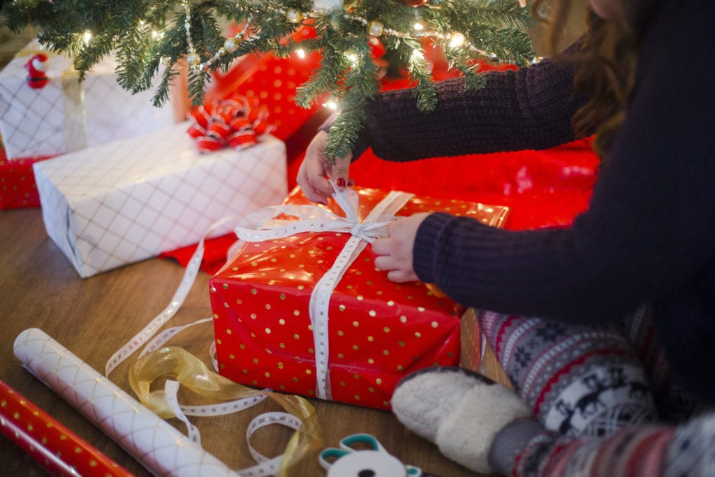 wrapping presents christmas tree