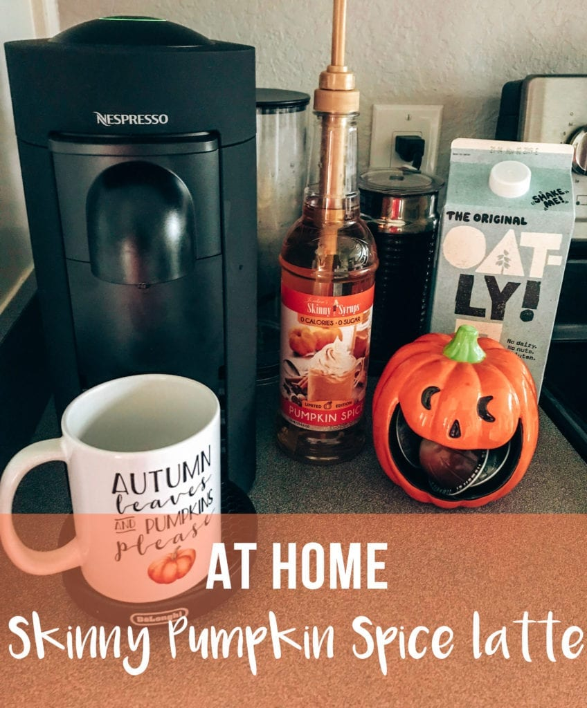 At Home Skinny Pumpkin Spice Latte by popular life and style blog, The Brunette and the Beach: image of a Nespresso maker, Pumpkin Spice syrup, oat milk, and a coffee mug.