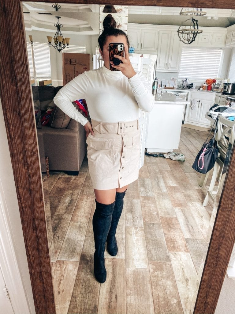 5 Fall Essentials featured by top US fashion blog, The Brunette & The Beach: image of a woman wearing a cream turtleneck, cream utility skirt and black thigh high boots