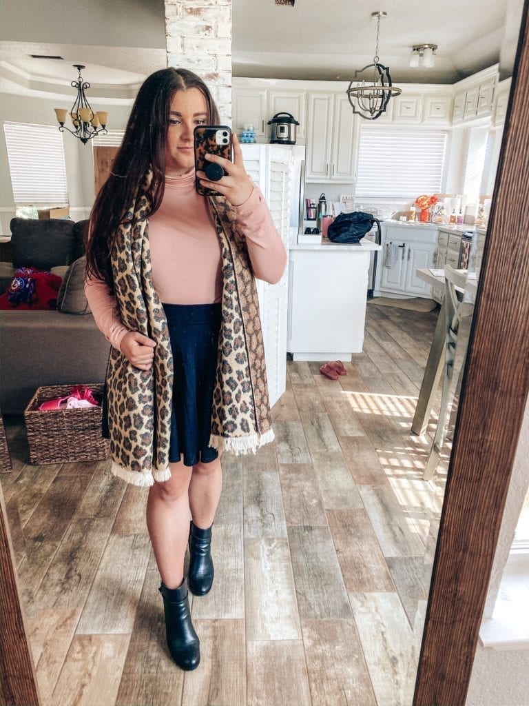 5 Fall Essentials featured by top US fashion blog, The Brunette & The Beach: image of a woman wearing a leopard scarf, pink turtleneck, black swing skirt and black booties