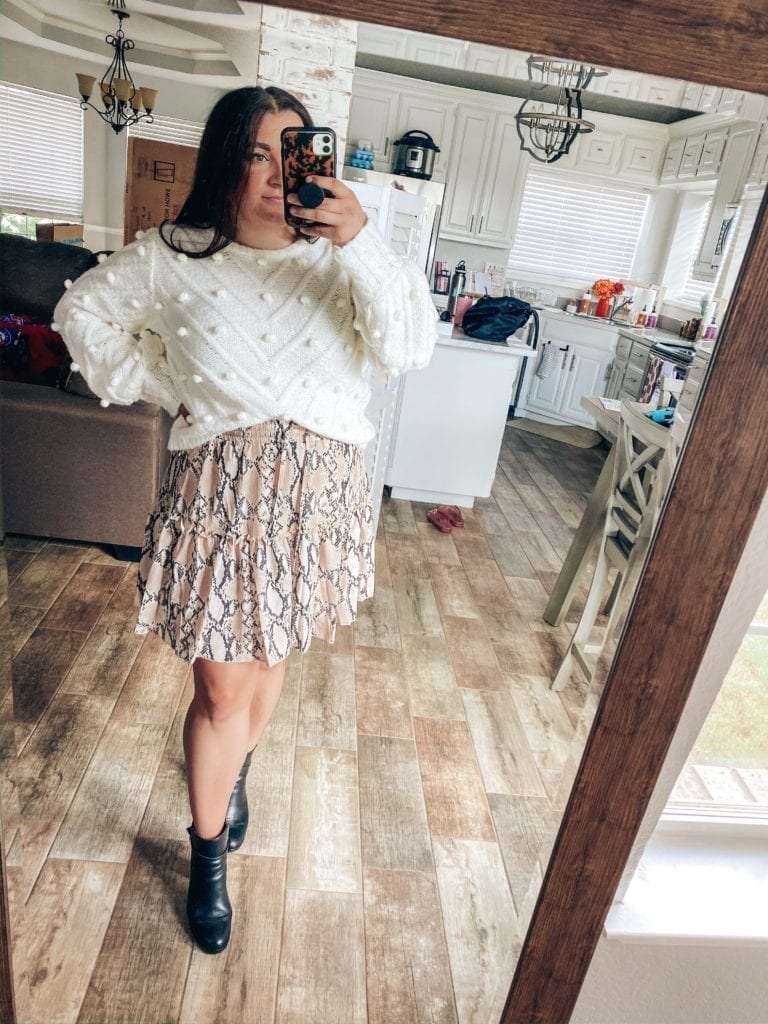 5 Fall Essentials featured by top US fashion blog, The Brunette & The Beach: image of a woman wearing a pompom sweater, snakeskin print mini skirt and black booties.
