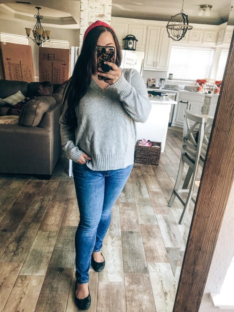 5 Fall Essentials featured by top US fashion blog, The Brunette & The Beach: image of a woman wearing an grey, old navy sweater, jeans, black flats and a pink headband